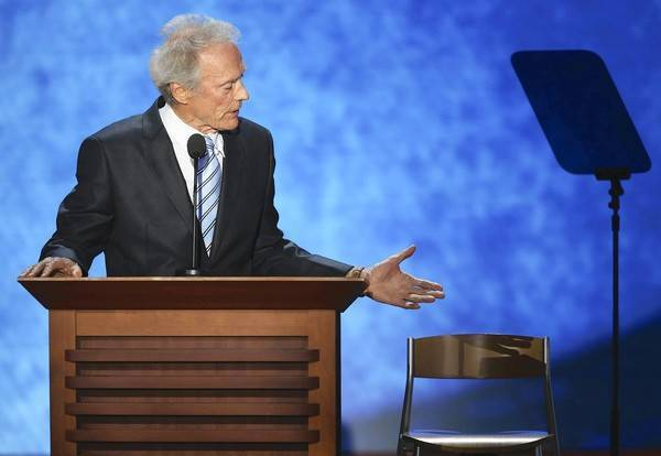 Clint Eastwood talking to chair